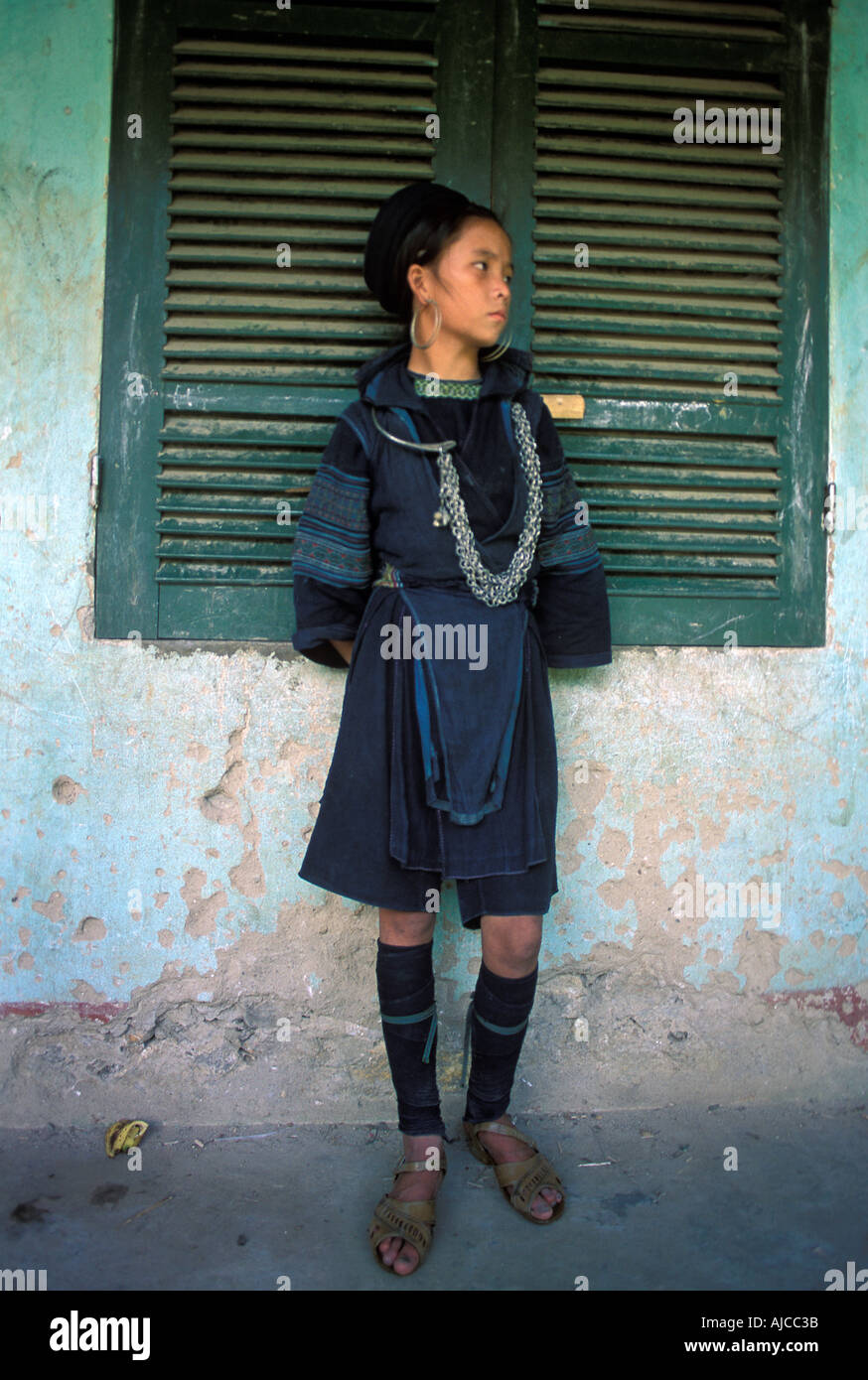 Black Hmong girl standing in a schoolhouse in a rural hamlet near Sapa Vietnam - Stock Image