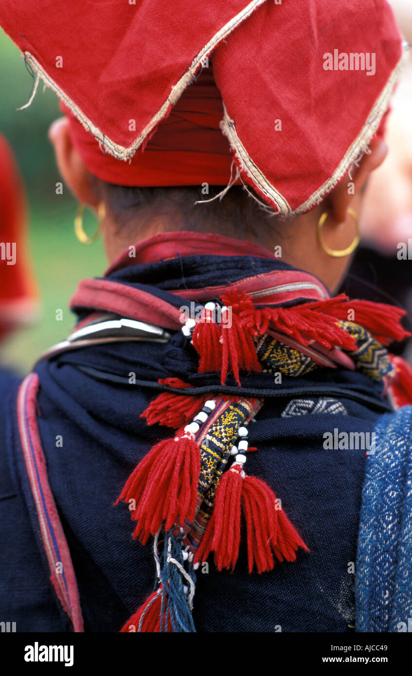 Woman from the Red Dao Dzao hilltribe in distinctive tribal costume Sapa Vietnam - Stock Image