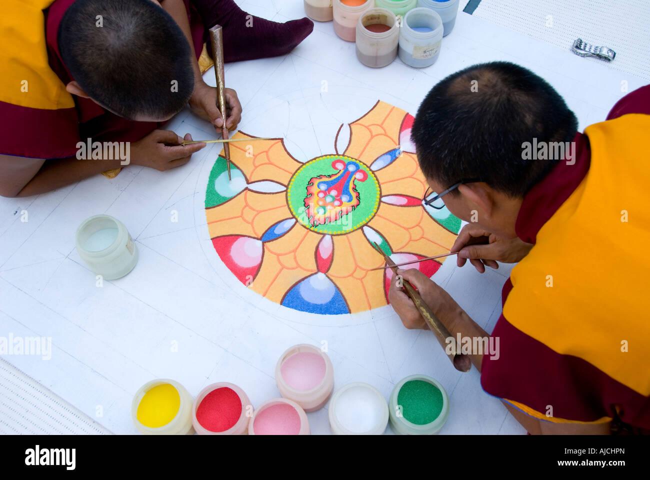 Tibetan monks working on sand mandala - Stock Image