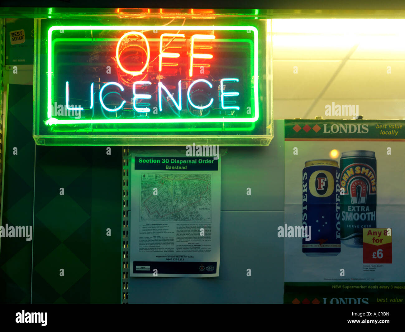 Off Licence Nork Surrey Displaying a Police Dispersal Order - Stock Image