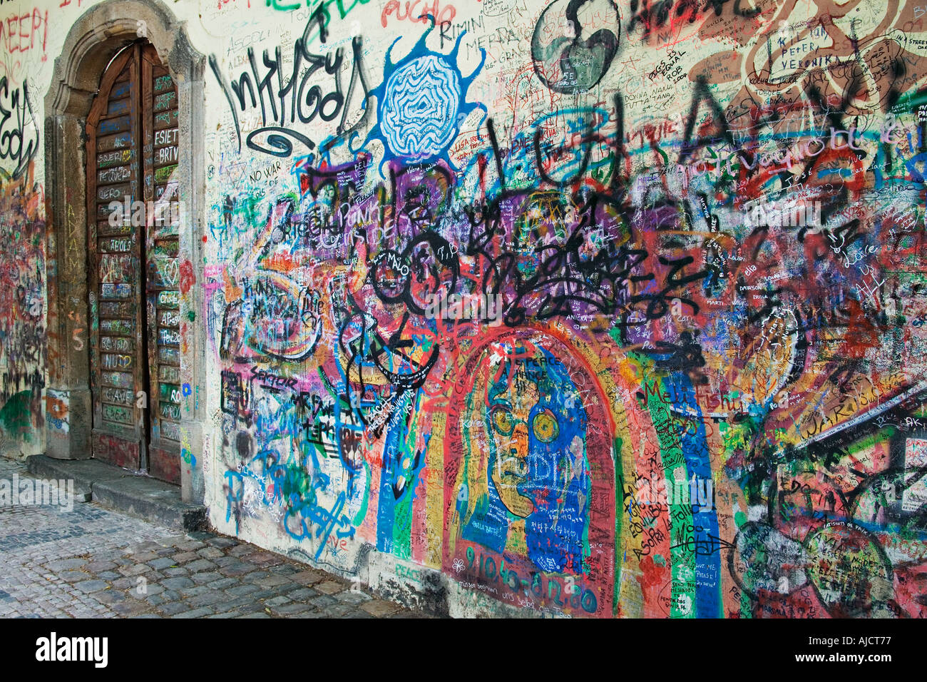 Graffitti covering the Lennon Wall opposite the French Embassy Wall came about by revolutionaries who inscribed anti government - Stock Image