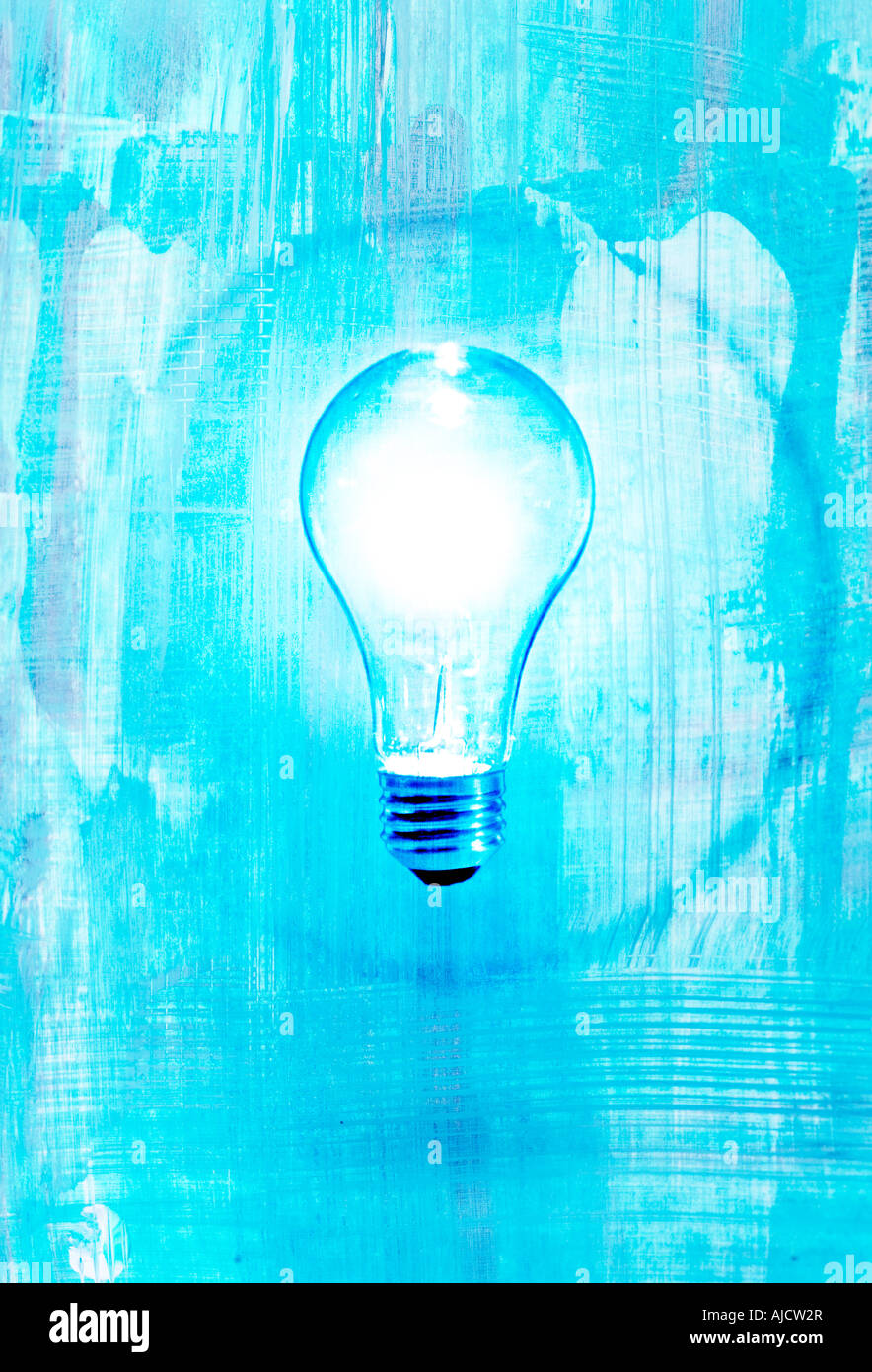 bright light bulb with blue background and circle showing idea or insight - Stock Image