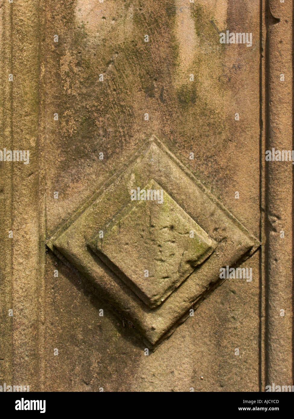 Diamond shape sculpted in stone gatepost Sandstone - Stock Image