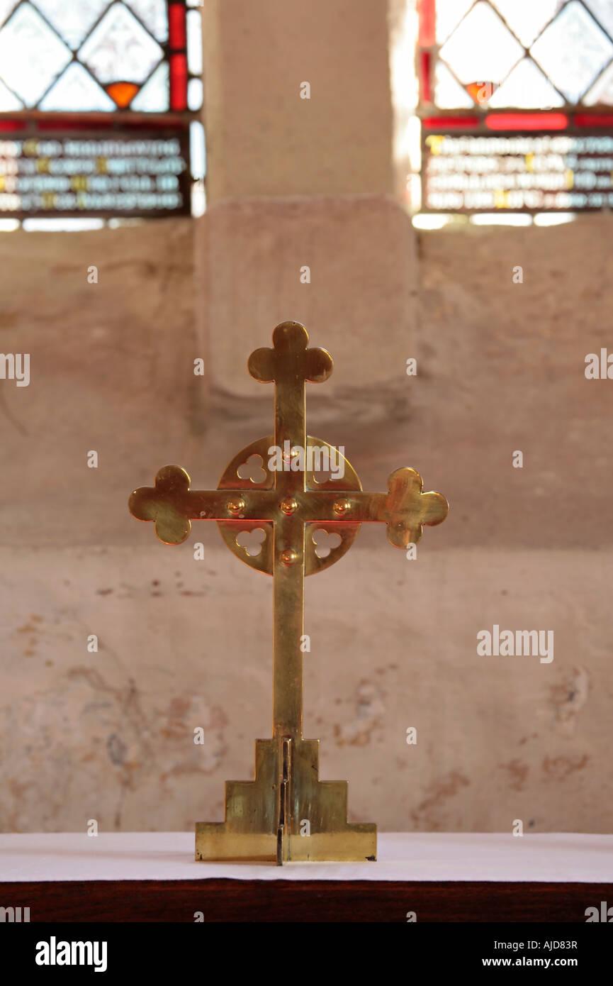 Brass wheel head cross on altar. UK - Stock Image