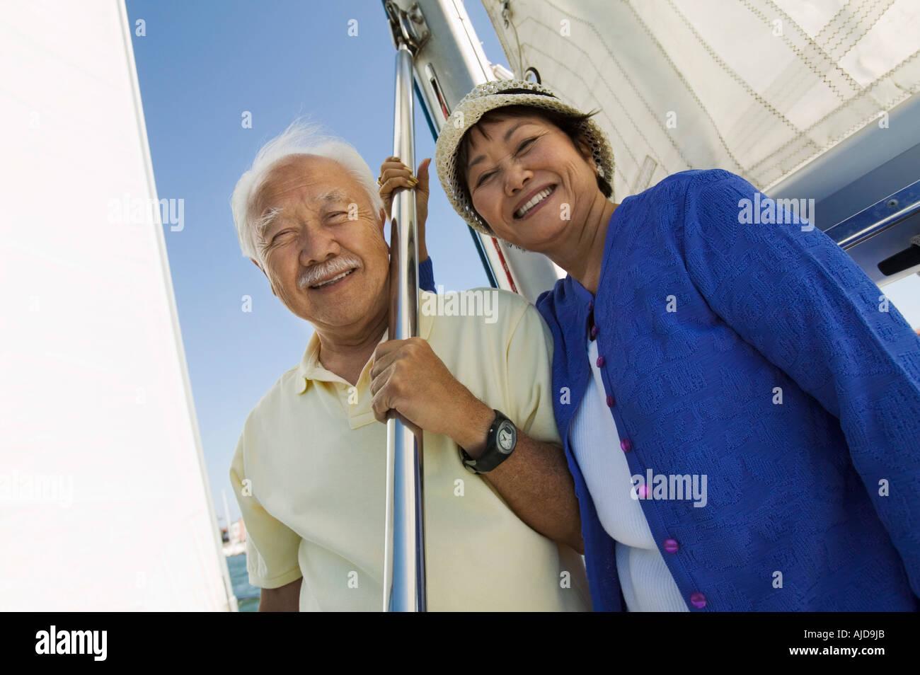 Senior couple on sailboat, (portrait) Stock Photo
