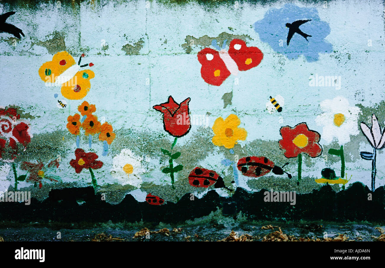 Naïve, pretty charming mural depicting flowers birds and butterflies - Stock Image
