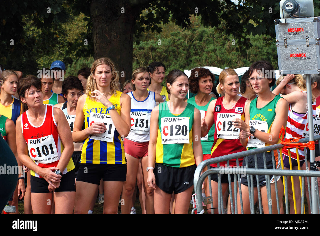 Women runners waiting to run in Midland 6 stage Road Relay race, Sutton Park, West Midlands, England, UK - Stock Image