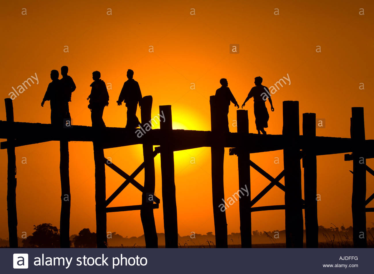 6c249c817ef127 Silhouettes of people walking across the iconic U Bein bridge over the  Ayerwaddy River at sunset Amarapura Myanmar