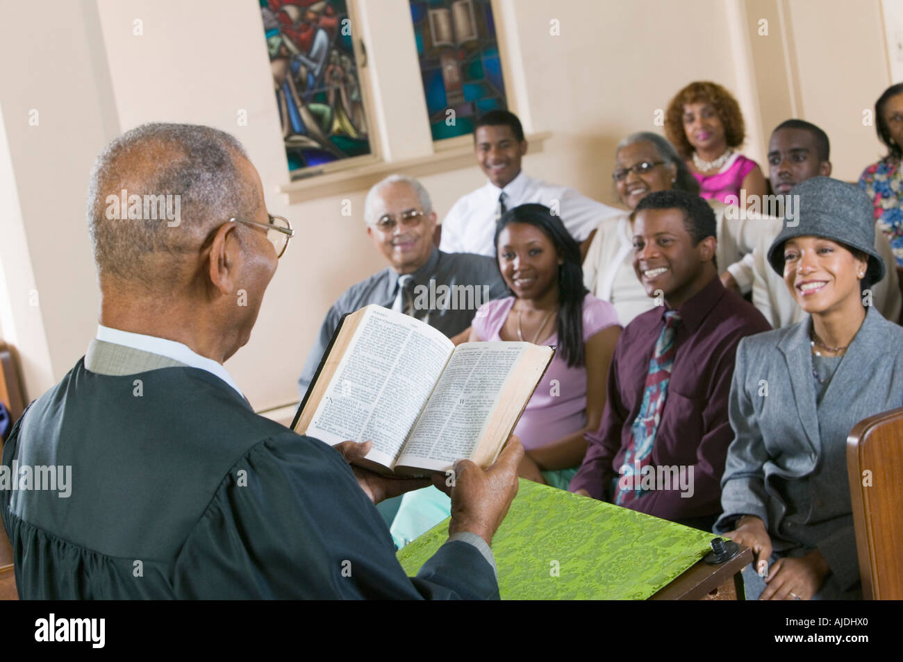 Minister Giving Sermon to congregation in Church, back view - Stock Image