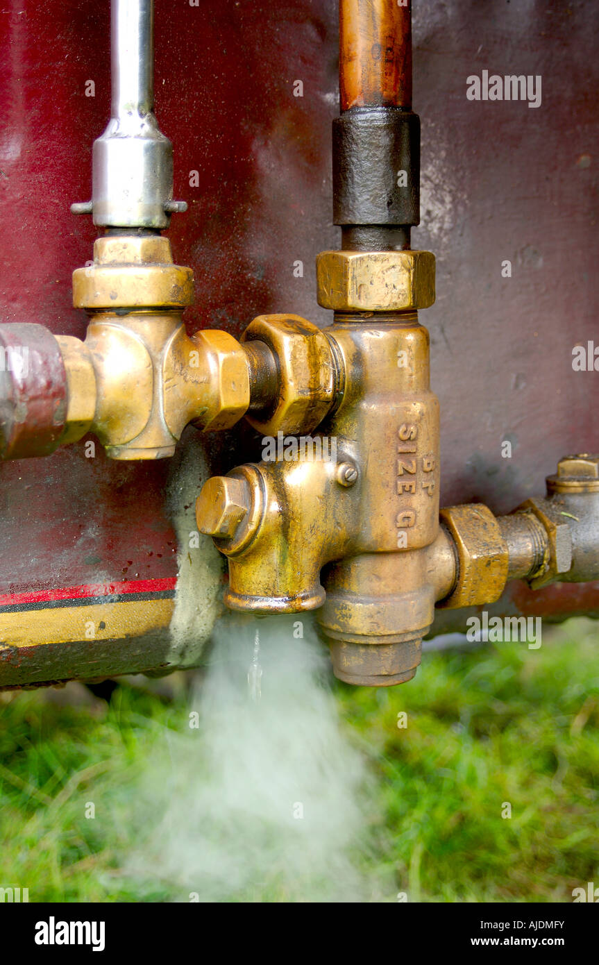 Pressure valve of a steam traction engine letting off steam - Stock Image