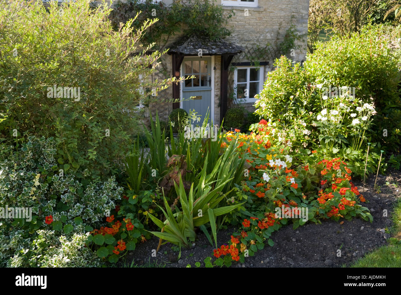 A cottage garden in the Cotswold town of Northleach, Gloucestershire - Stock Image