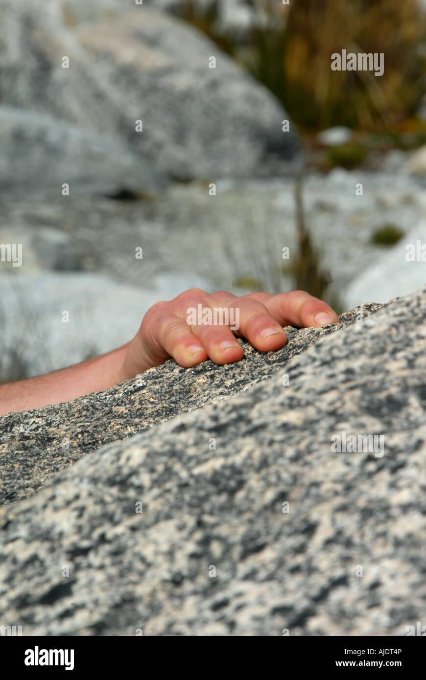 A climber reaches the top of a climb near Sorata, Bolivia, South America. - Stock Image