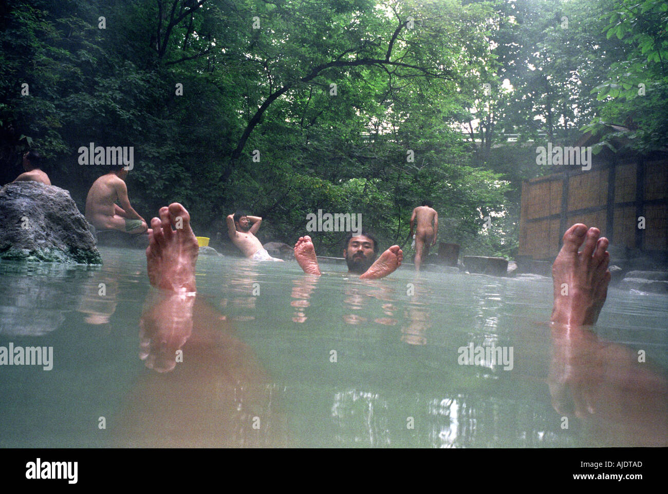 Men Relax In A Hot Spring Called An Onsen In Japan Stock -4280