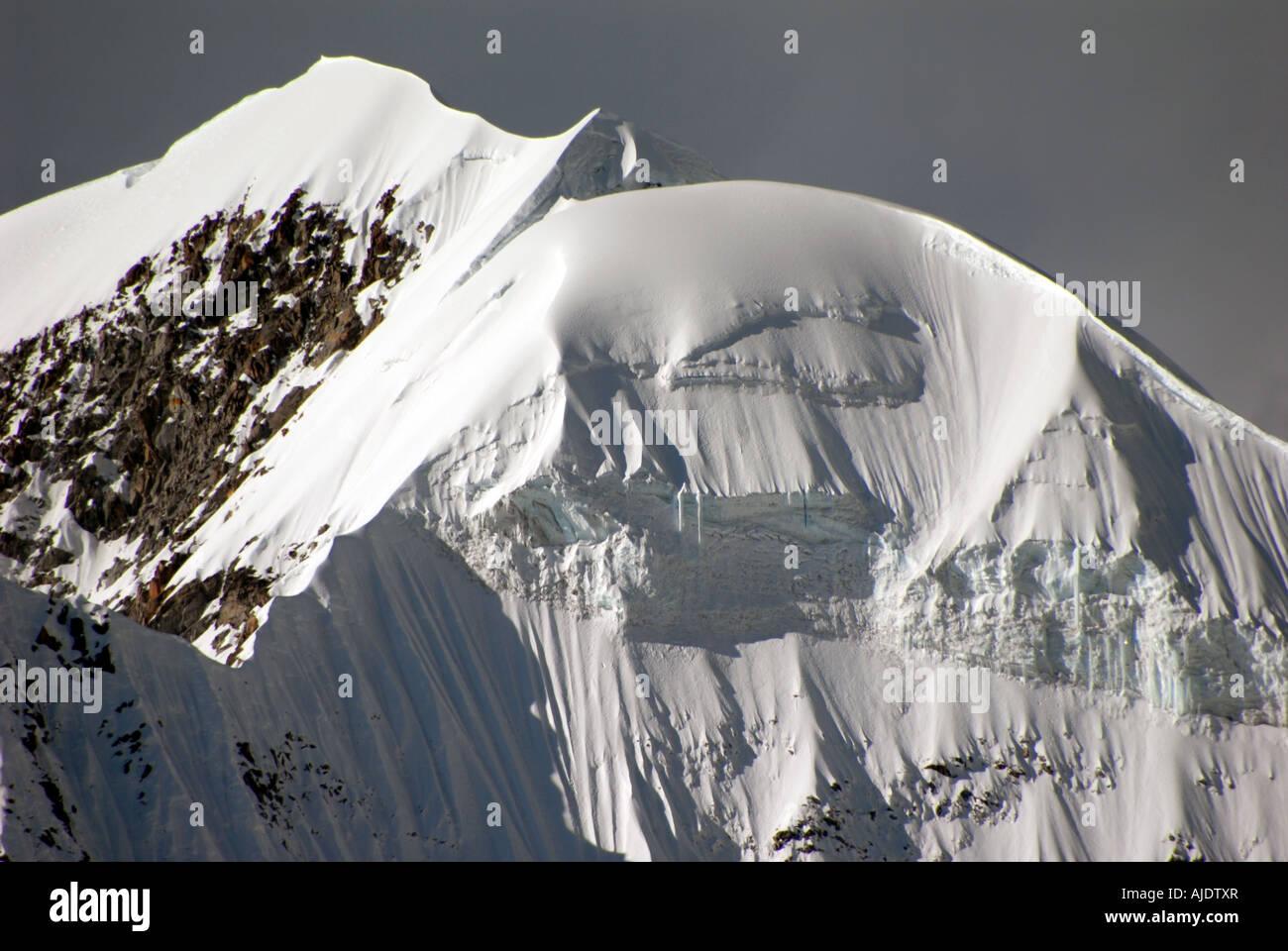 Mount Illiampu massif as viewed from Lagunas Glaciar near Sorata, Bolivia, South America. - Stock Image