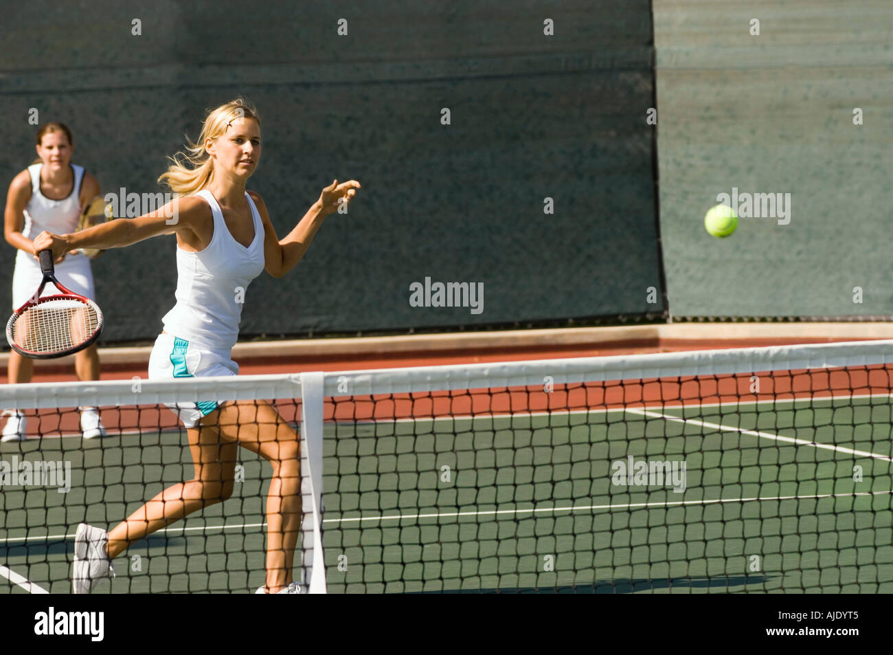 Doubles tennis Player Hitting tennis ball with Backhand - Stock Image