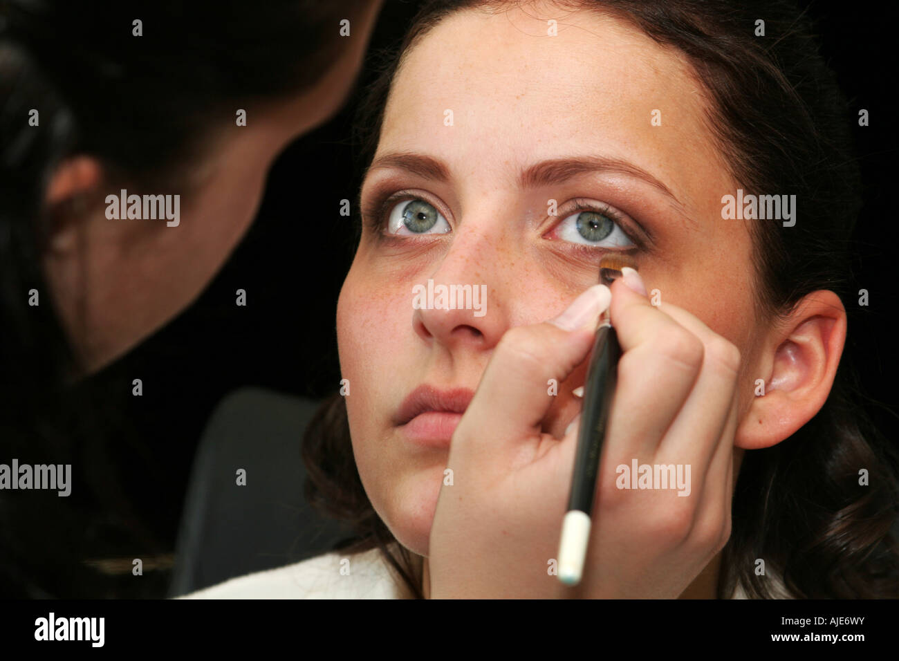beautiful young woman getting a makeup - Stock Image