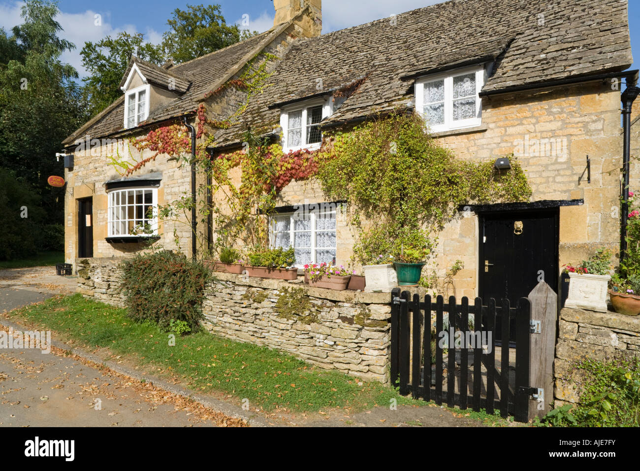 cottage office. A Stone Cottage Next To The Post Office And Shop In Cotswold Village Of Temple Guiting, Gloucestershire O