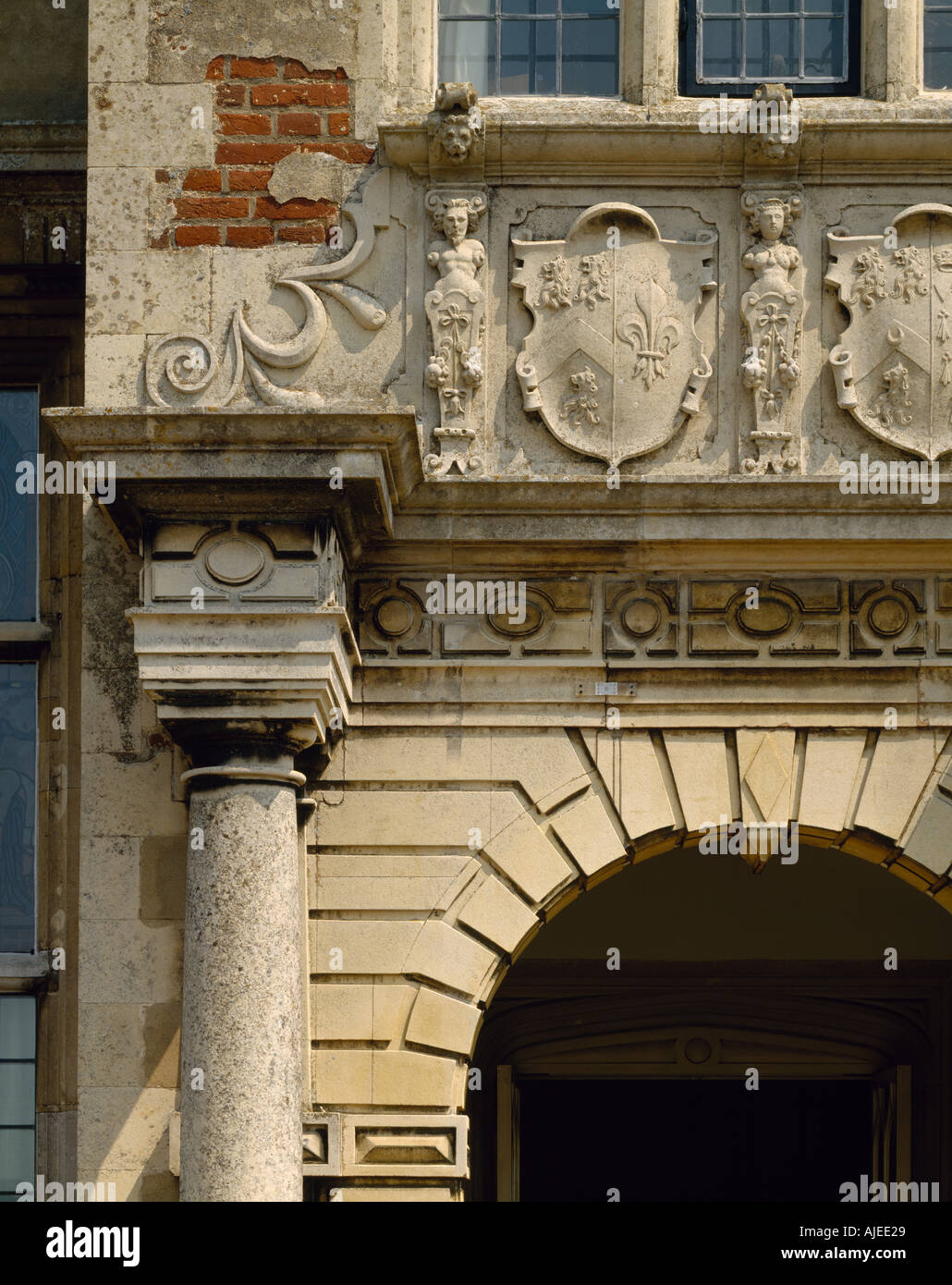 The coat of arms above the entrance belongs to Sir John Wyndham 1558 1645 at Felbrigg Hall Norfolk - Stock Image