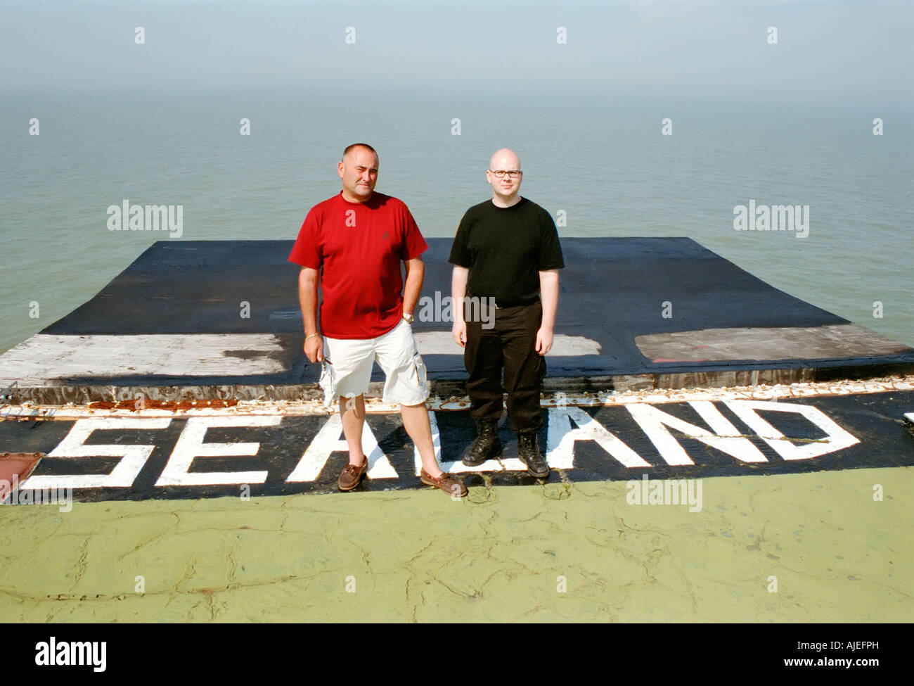Prince Michael Bates and Havenco founder Ryan Lackey on Sealand's helipad - Stock Image