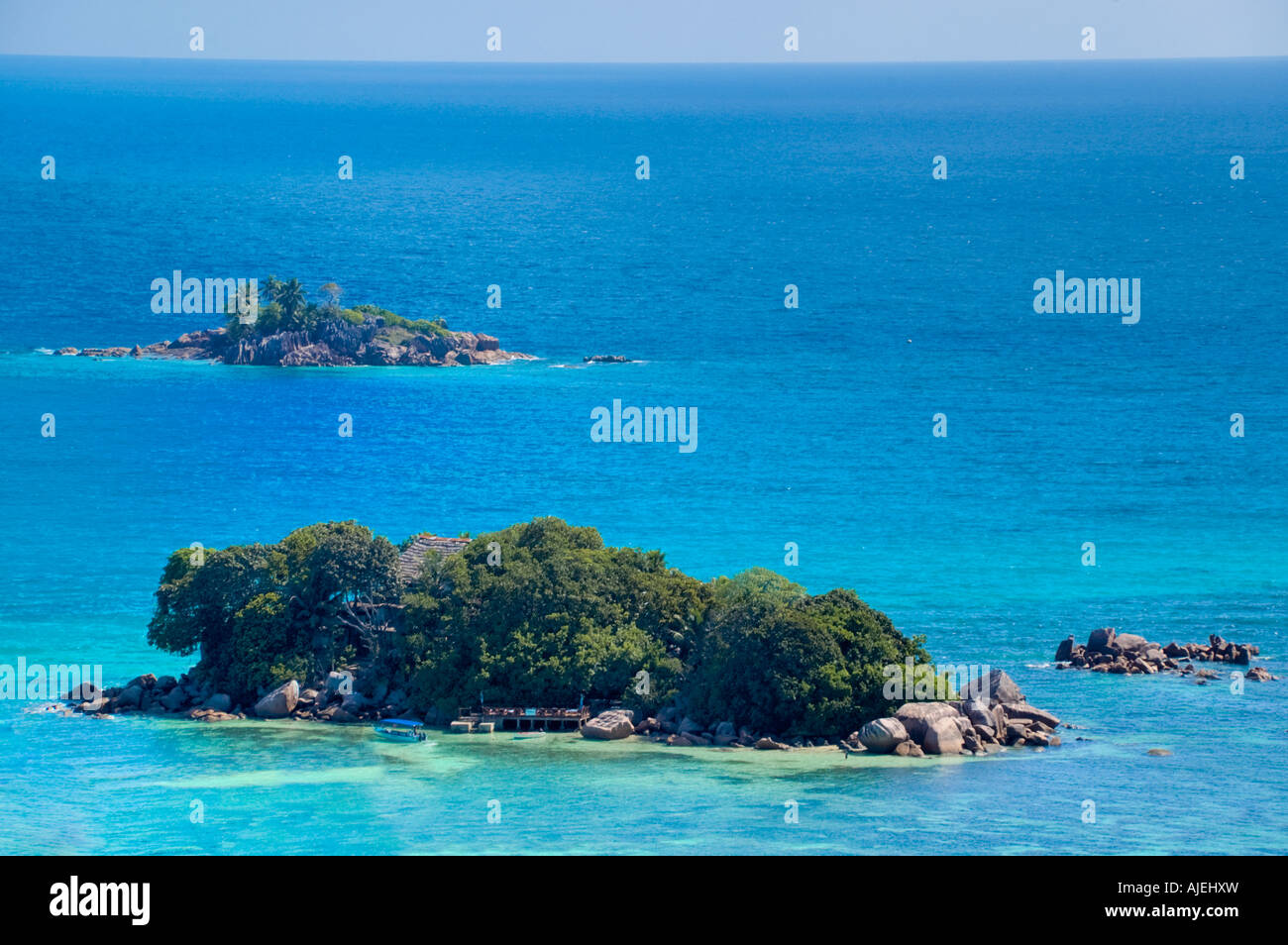 Tiny Chauve Souris and Sant Pierre islets covered in lush tropical vegetation Stock Photo