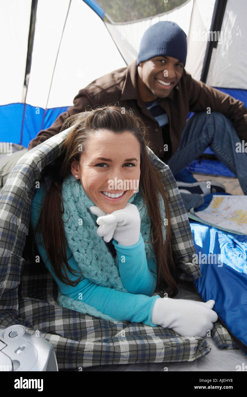 Young couple relaxing in tent. Stock Photo