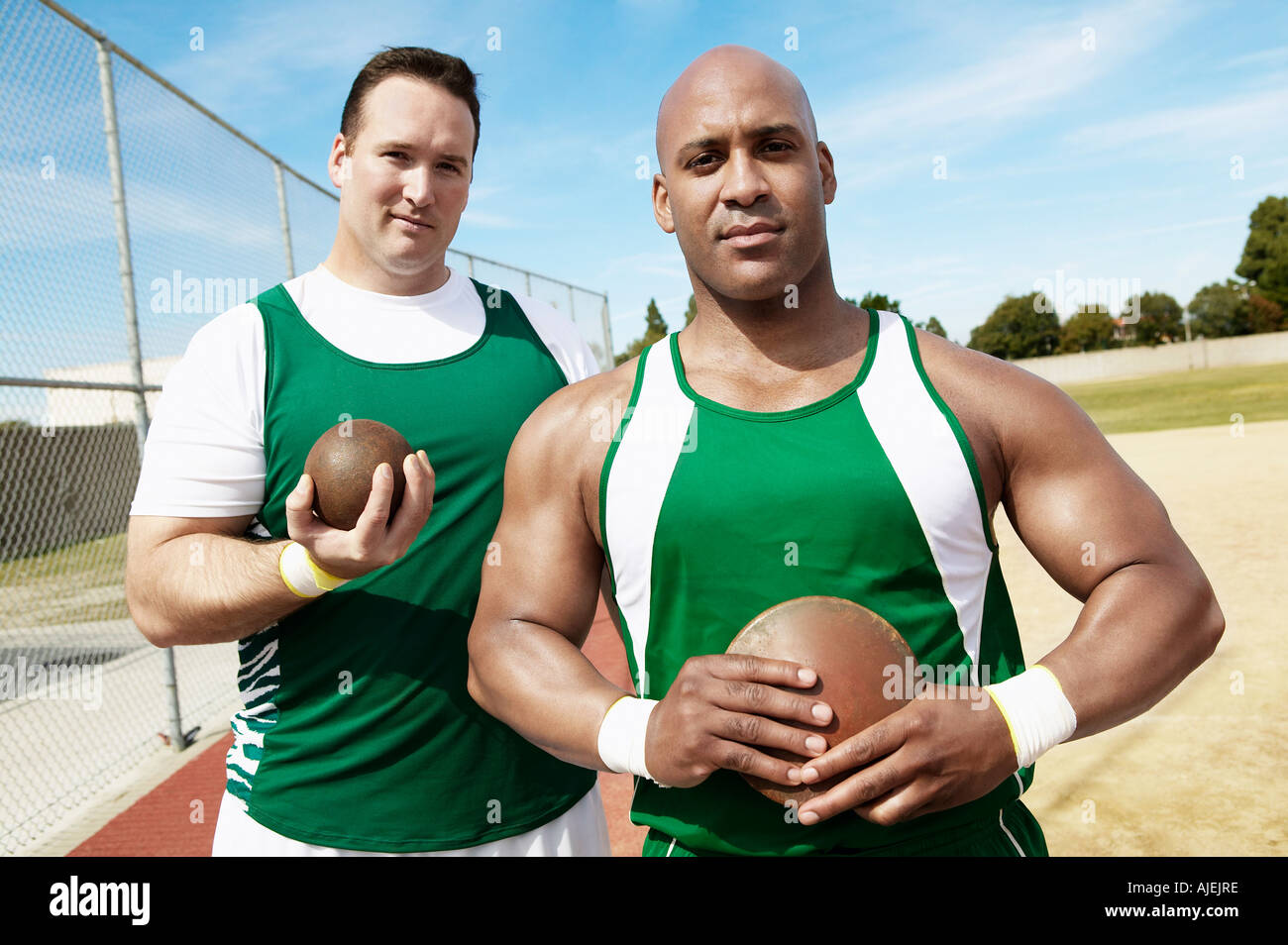 Shot Putters holding shot put and discus, half length - Stock Image