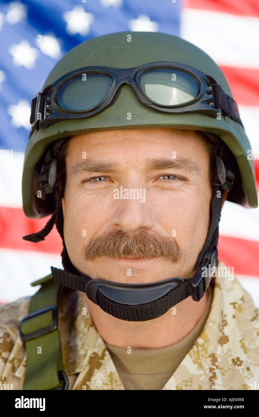 Soldier with moustache in front of United States flag, (close-up), (portrait) - Stock Image