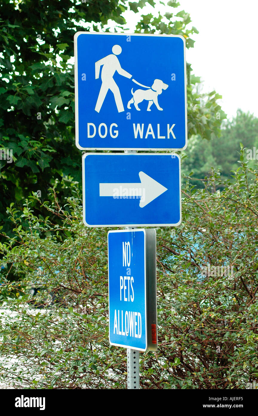 dog walking area sign in public parking area on highway some with no