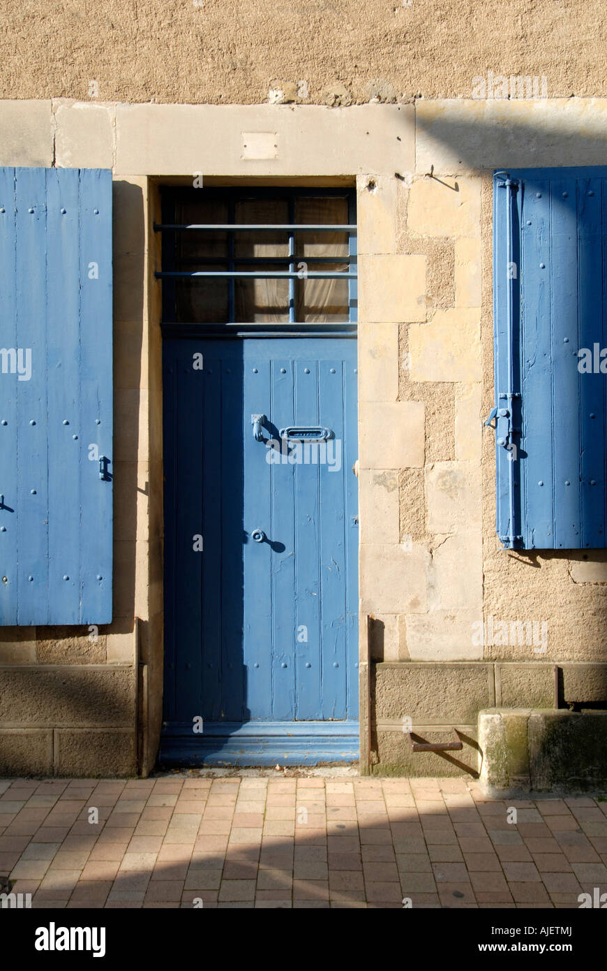 Blue door and shutters, Montmorillon, Vienne, France. - Stock Image