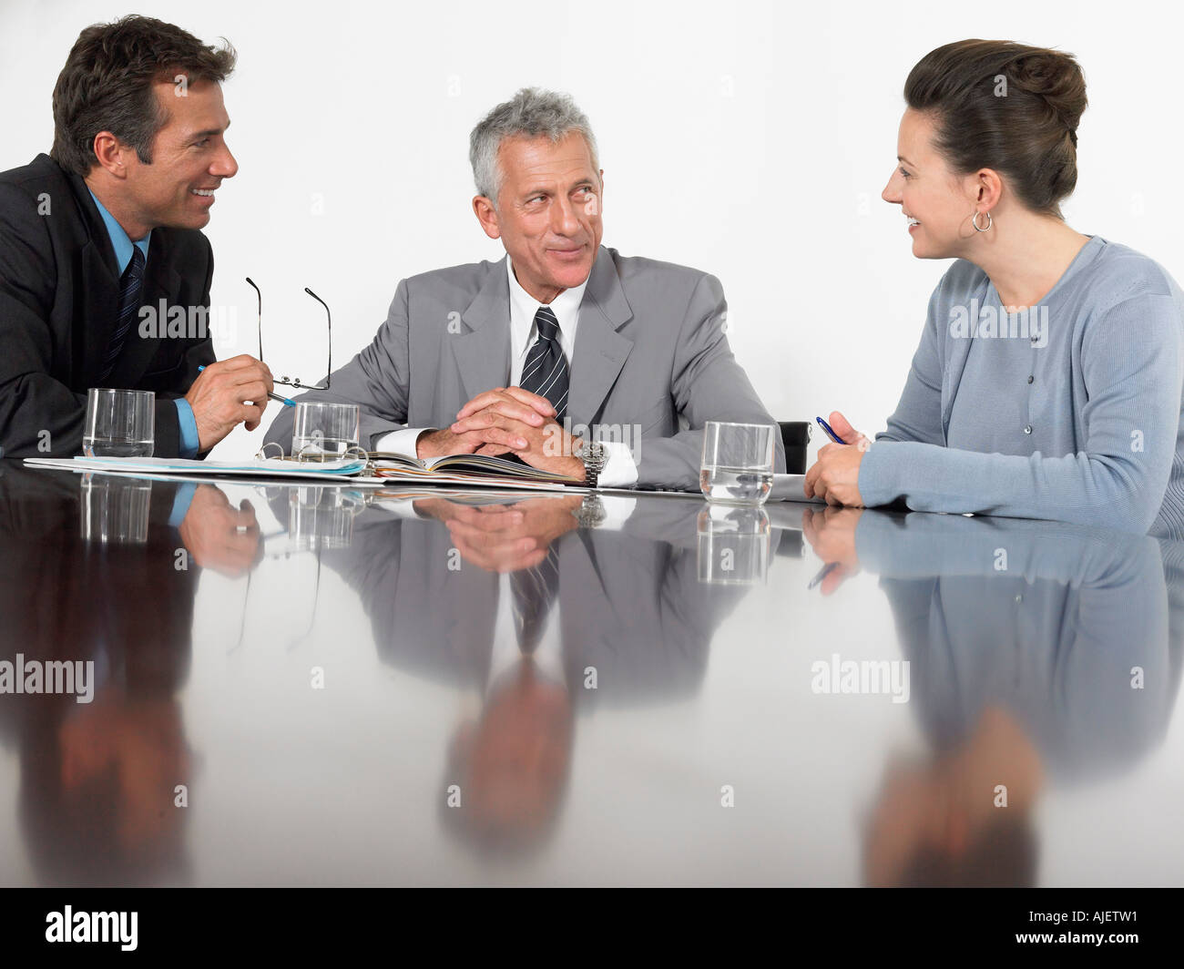 Three business colleagues in conference meeting - Stock Image