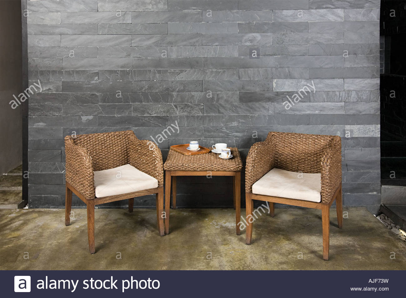 Wicker chairs and table - Stock Image
