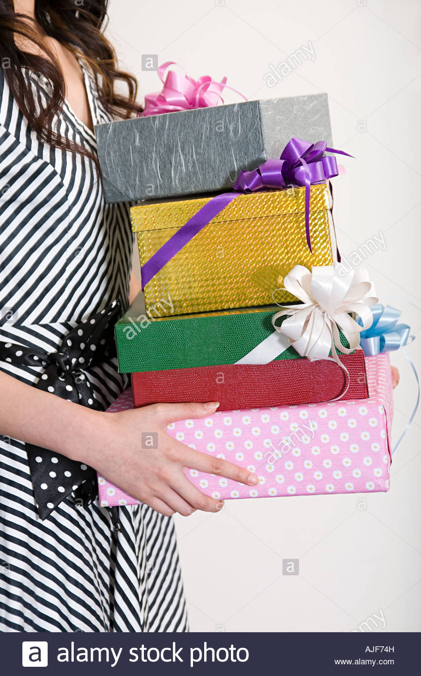 Woman Holding A Stack Of Gifts