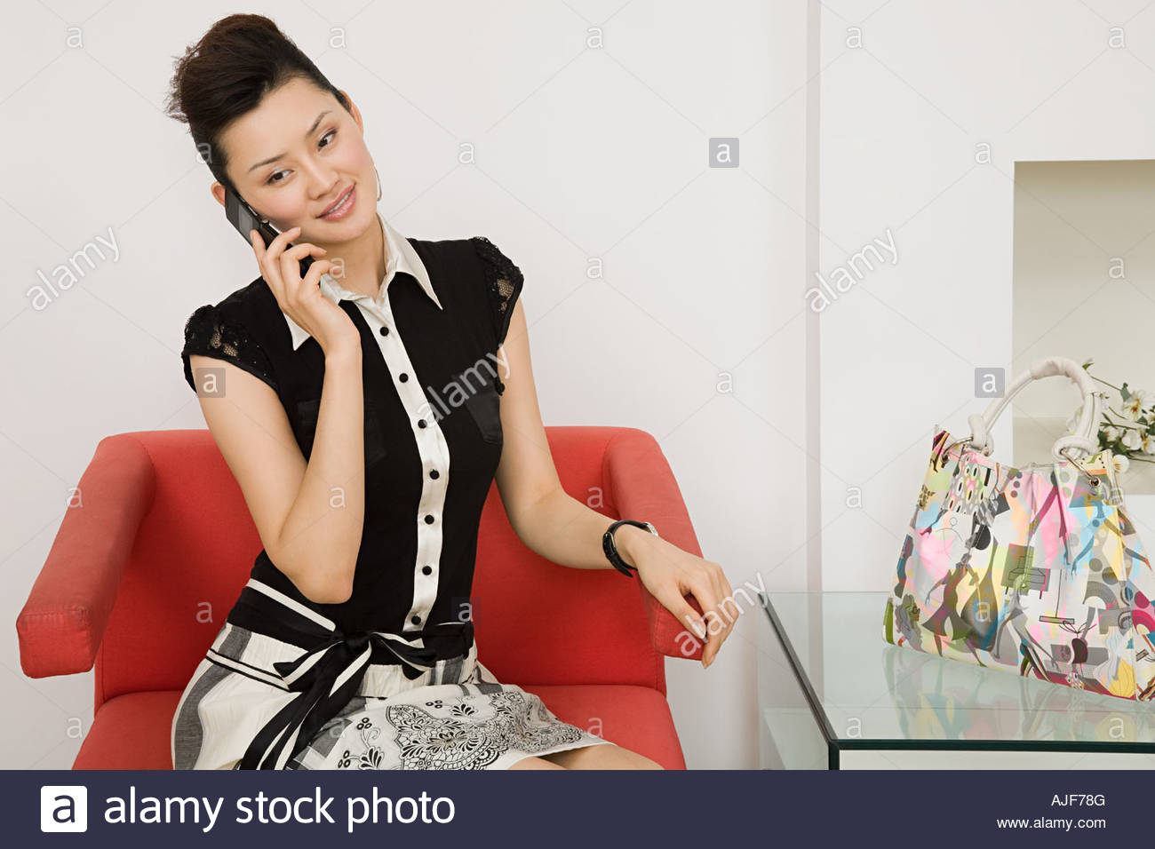Young woman making a telephone call - Stock Image