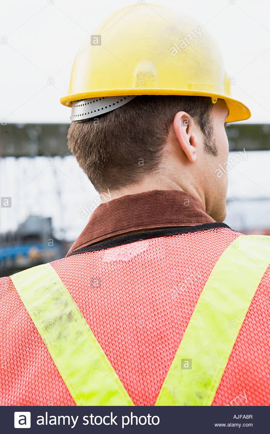 Man wearing hard hat - Stock Image