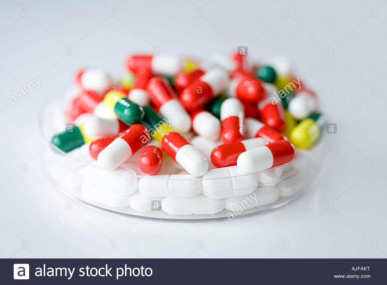 Tablets in a petri dish - Stock Image