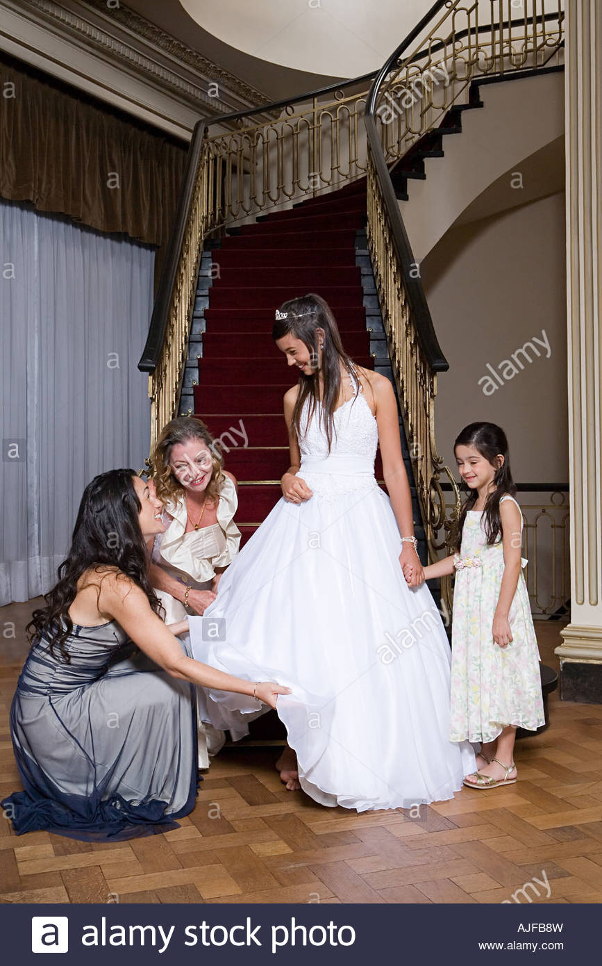 Girl and relations preparing for quinceanera - Stock Image