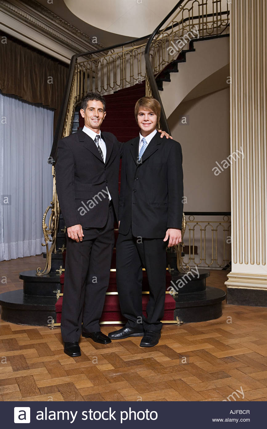 Father and son in suits - Stock Image