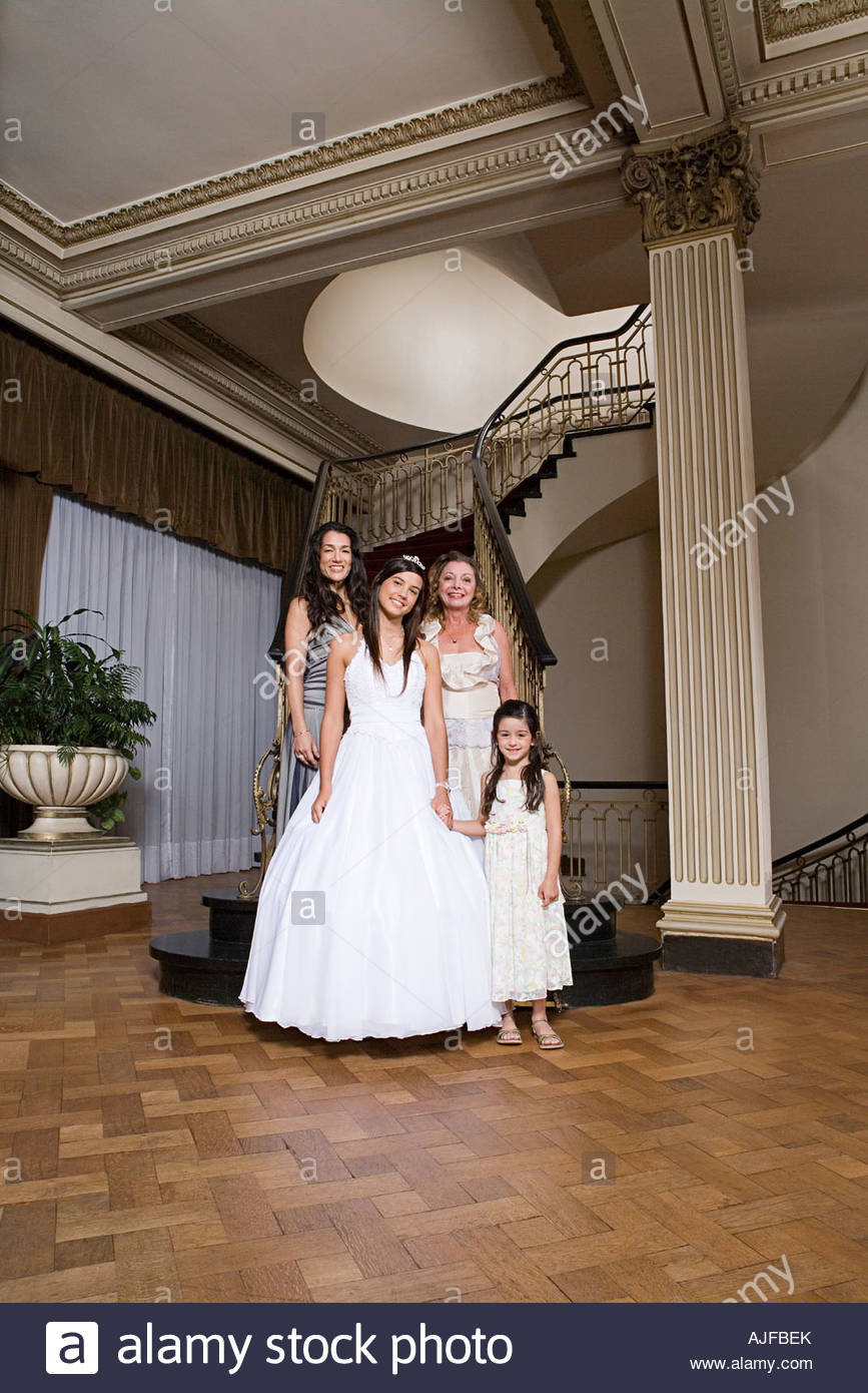 Quinceanera with her female relations - Stock Image