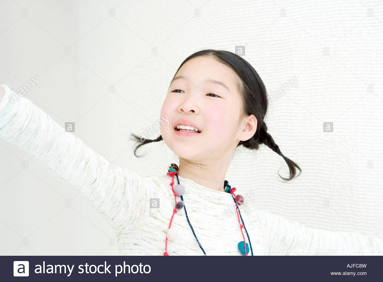 Girl with arms open - Stock Image