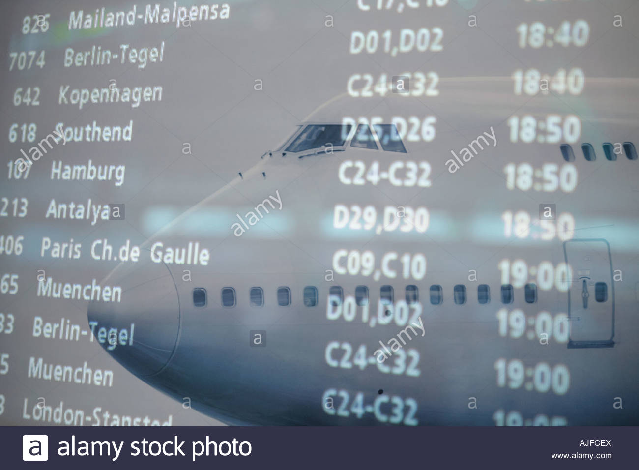 Airplane and departure board - Stock Image