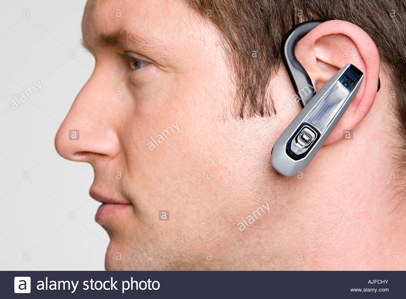 Man using hands free device - Stock Image