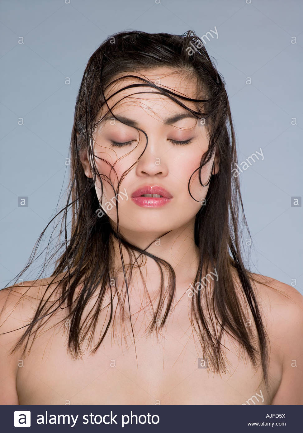 Chinese woman with her eyes closed - Stock Image