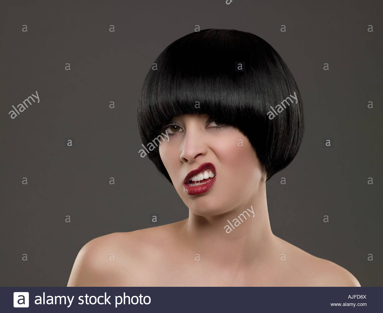 Young woman grimacing - Stock Image