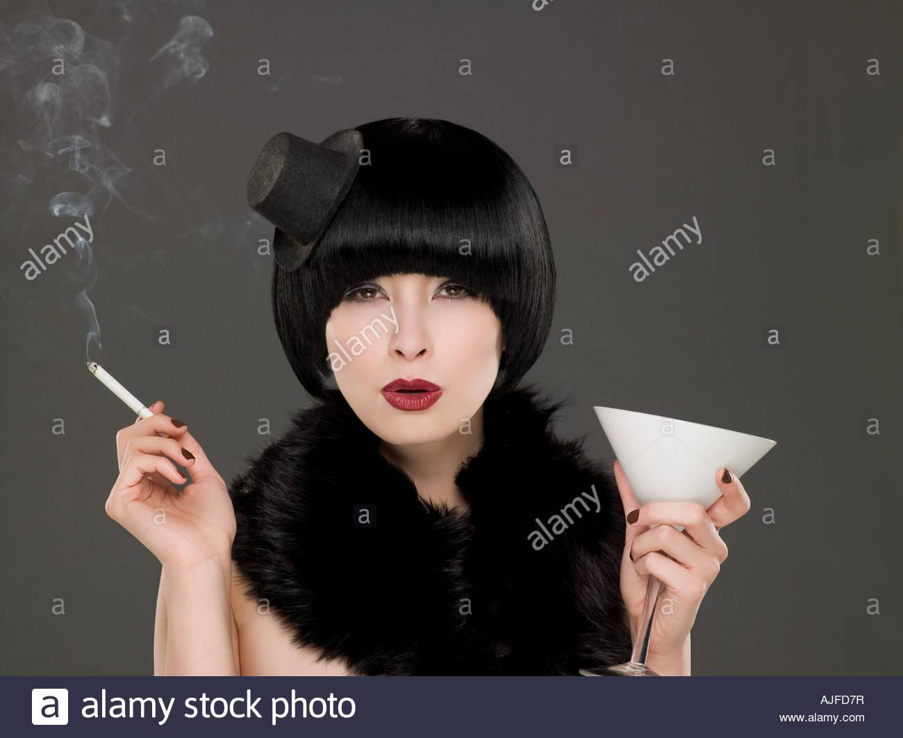 Woman smoking and drinking - Stock Image