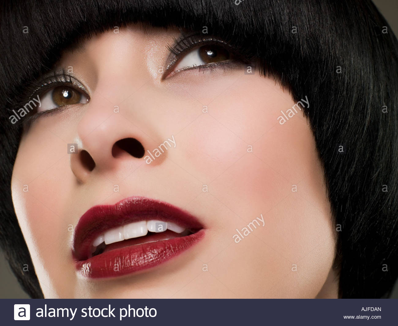 Headshot of a woman with bob hairstyle - Stock Image