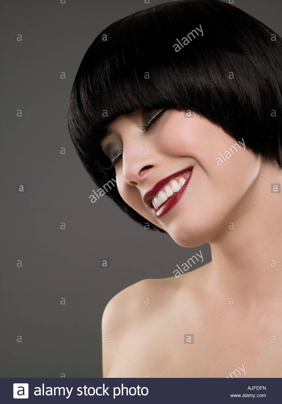 Smiling woman with a bob hairstyle - Stock Image