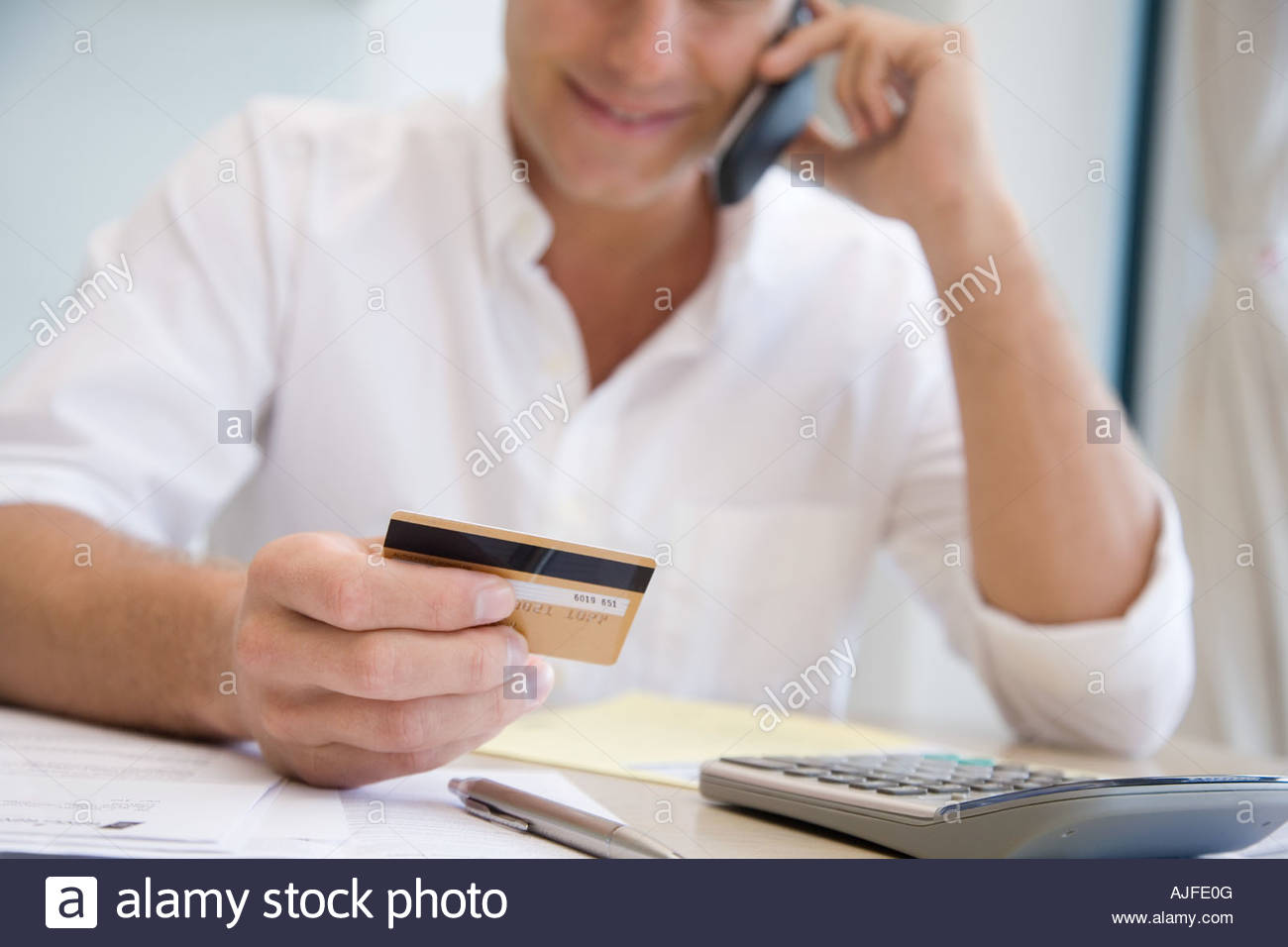 A man telephone banking - Stock Image