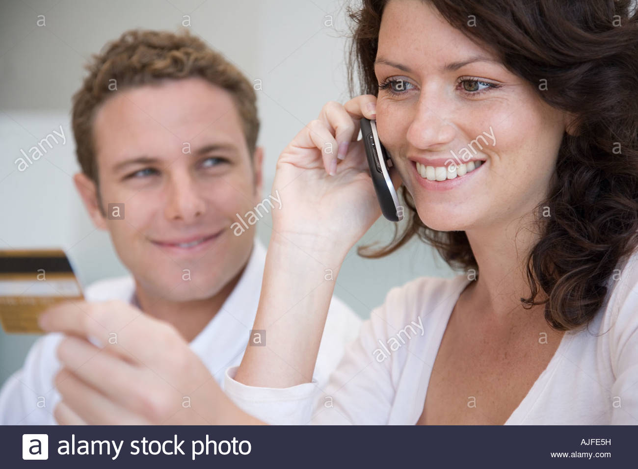 A couple telephone banking - Stock Image