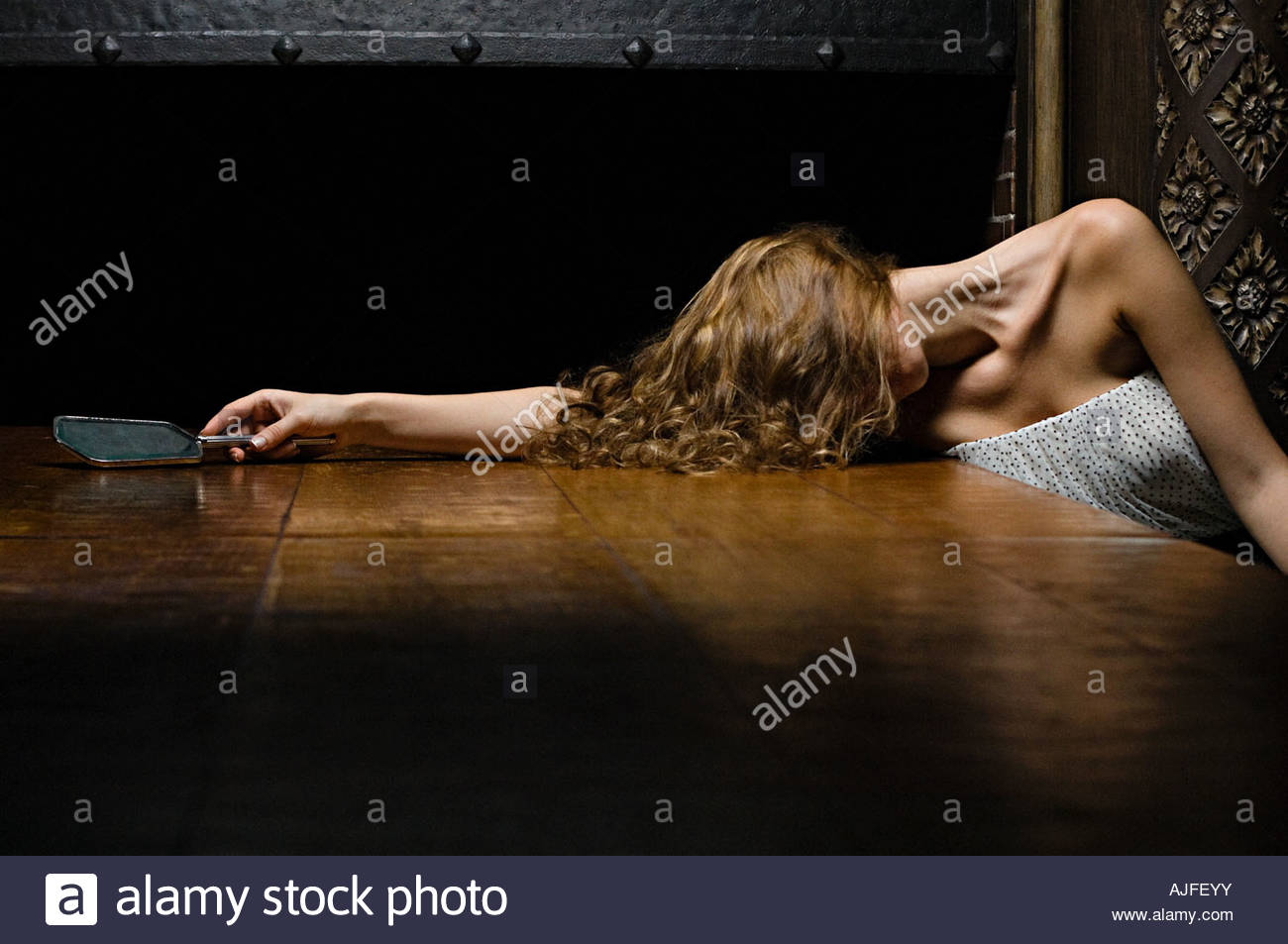 Woman leaning on a wooden table Stock Photo