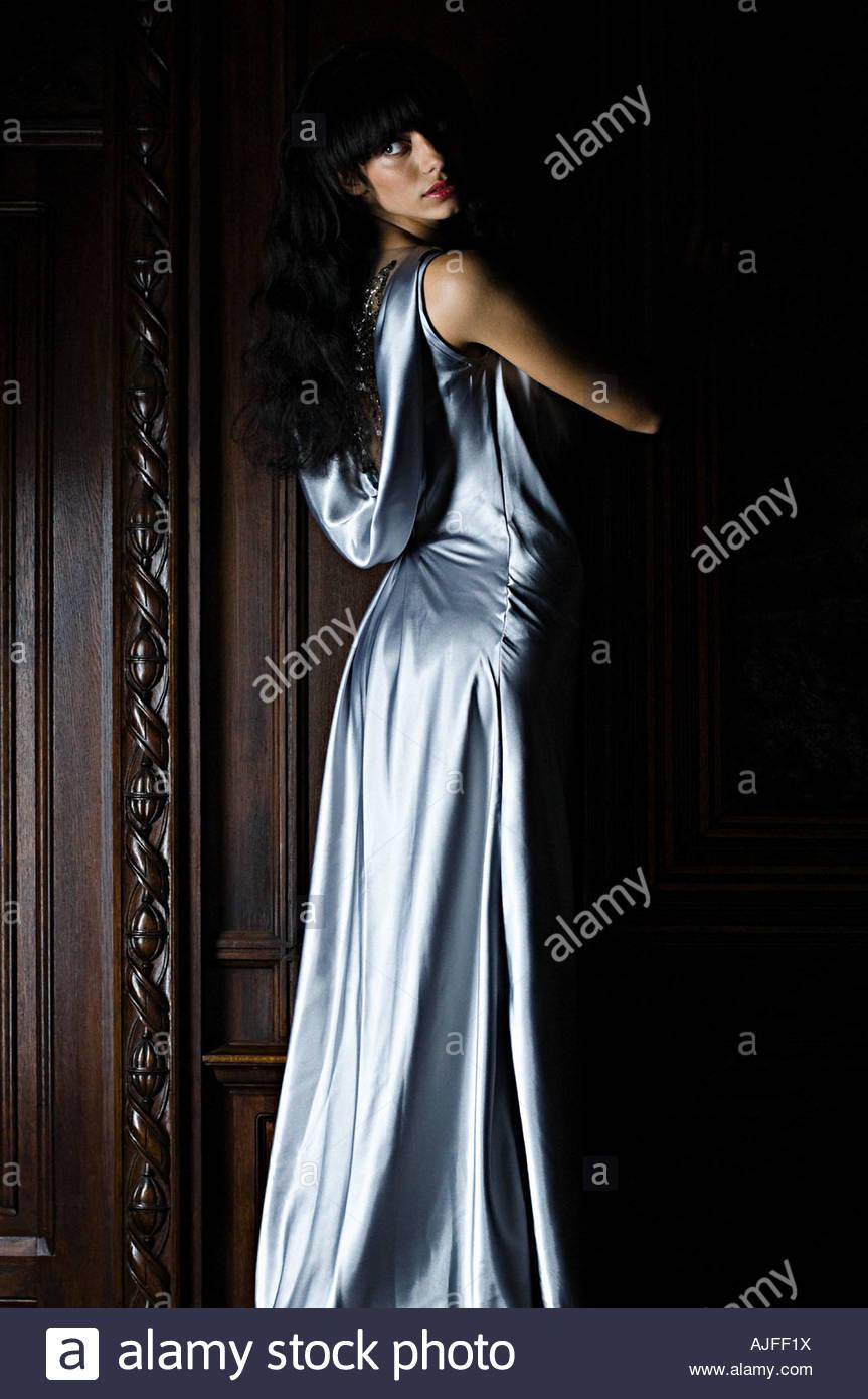 Woman wearing a blue silk dress - Stock Image
